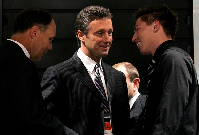 COLUMBUS, OH - JUNE 22:  General manager Doug Wilson of the San Jose Sharks looks on as ninth overall pick Logan Couture is introduced during the first round of the 2007 NHL Entry Draft at Nationwide Arena on June 22, 2007 in Columbus, Ohio.  (Photo by Br