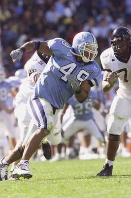 CHAPEL HILL, NC - NOVEMBER 10:  Defensive End Julius Peppers #49 of the North Carolina Tar Heels looks to get by offensive lineman Michael Collins #79 of the Wake Forest Demon Deacons during the game on November 10, 2001 at Kenan Stadium in Chapel Hill, N