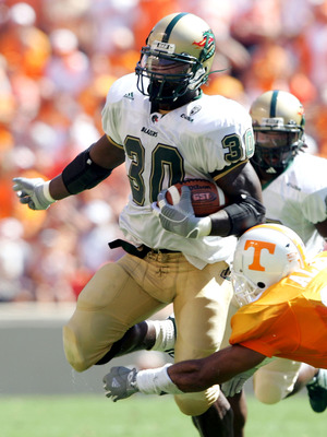 KNOXVILLE, TN - SEPTEMBER 3:  Corey White #30 of UAB is brought down by Jason Allen #18 of Tennessee on September 3, 2005  at Neyland Stadium in Knoxville, Tennessee. The Volunteers defeated UAB 17-10.  (Photo by Elsa/Getty Images)