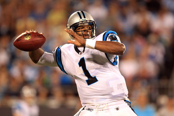 CHARLOTTE, NC - AUGUST 13:  Cam Newton #1 of the Carolina Panthers drops back to throw a pass during their preseason game against the New York Giants at Bank of America Stadium on August 13, 2011 in Charlotte, North Carolina.  (Photo by Streeter Lecka/Get