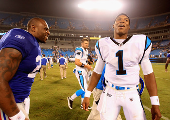 CHARLOTTE, NC - AUGUST 13:  Cam  Newton #1 of the Carolina Panthers talks with Brandon Jacobs #27 of the New York Giants after their preseason game at Bank of America Stadium on August 13, 2011 in Charlotte, North Carolina.  (Photo by Streeter Lecka/Getty