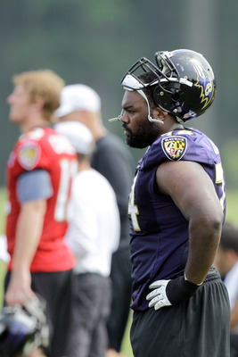 OWINGS MILLS, MD - JULY 29: Michael Oher #74 of the Baltimore Ravens works out during training camp on July 29, 2011 in Owings Mills, Maryland.  (Photo by Rob Carr/Getty Images)