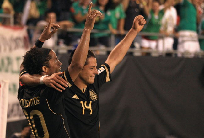 CHARLOTTE, NC - JUNE 09:  Javier Hernandez celebrates with teammate Giovani Dos Santos #10 of Mexico after Dos Santos scored a goal against Cuba during their game in the CONCACAF Gold Cup at Bank of America Stadium on June 9, 2011 in Charlotte, North Caro