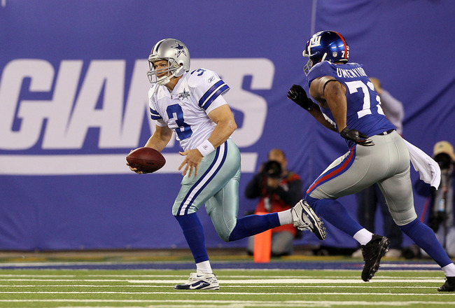 EAST RUTHERFORD, NJ - NOVEMBER 14:  Jon Kitna #3 of the Dallas Cowboys runs the ball against Osi Umenyiora #72 of the New York Giants on November 14, 2010 at the New Meadowlands Stadium in East Rutherford, New Jersey. The Cowboys defeated the Giants 33-20