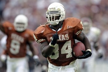 27 Nov 1998:  Tailback Ricky Williams #34 of the Texas Longhorns breaks the NCAA career yards record while running with the ball during a game against the Texas A&M Aggies at the Memorial Stadium in Austin, Texas. The Longhorns defeated the Aggies 26-24.