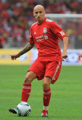 KUALA LUMPUR, MALAYSIA - JULY 16: Jonjo Shelvey of Liverpool passes the ball during the pre-season friendly match between Malaysia and Liverpool at the Bukit Jalil National Stadium on July 16, 2011 in Kuala Lumpur, Malaysia. (Photo by Stanley Chou/Getty I