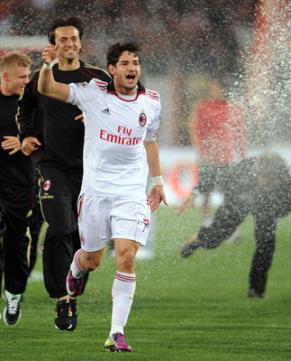 ROME, ITALY - MAY 07:  Pato of Milan celebrates the victory after the Serie A match between AS Roma and AC Milan at Stadio Olimpico on May 7, 2011 in Rome, Italy.  (Photo by Giuseppe Bellini/Getty Images)