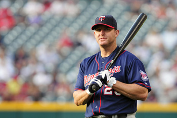 CLEVELAND, OH - AUGUST 12: Designated hitter Jim Thome #25 of the Minnesota Twins warms up prior to the game against the Cleveland Indians at Progressive Field on August 12, 2011 in Cleveland, Ohio. (Photo by Jason Miller/Getty Images)