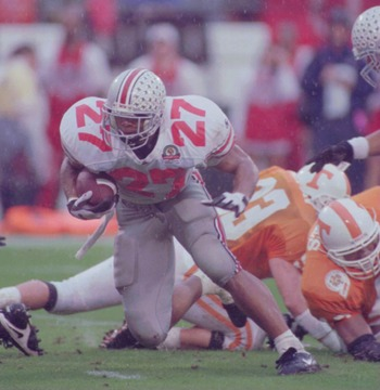 1 JAN 1996:  EDDIE GEORGE OF OHIO STATE #27, THE HEISMAN AWARD WINNER, RUNS WITH THE BALL DURING THEIR DEFEAT BY TENNESSEE  IN THE COMP USA FLORIDA CITRUS BOWL AT THE CITRUS BOWL IN ORLANDO.  ALTHOUGH EDDIE GEORGE RUSHED FOR MORE THAN 100 YARDS , TENNESSE