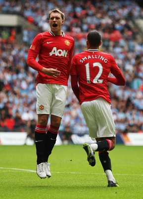 LONDON, ENGLAND - AUGUST 07:  Phil Jones of Manchester United celebrates with goalscorer Chris Smalling during the FA Community Shield match sponsored by McDonald's between Manchester City and Manchester United at Wembley Stadium on August 7, 2011 in Lond
