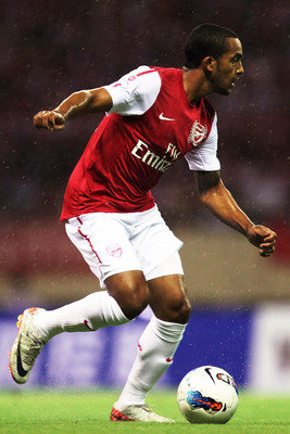 HANGZHOU, CHINA - JULY 16:  Theo Walcott of Arsenal in action during the pre-season friendly match between Hangzhou Greentown and Arsenal at Yiwu Meihu Stadium on July 16, 2011 in Hangzhou, China. (Photo by Lintao Zhang/Getty Images)