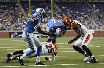 DETROIT - AUGUST 12:  Quarterback Shaun Hill #14 of the Detroit Lions runs seven yards for a second quarter touchdown during the game against the Cincinnati Bengals at Ford Field on August 12, 2011 in Detroit, Michigan.  (Photo by Leon Halip/Getty Images)