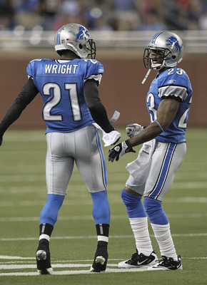 DETROIT - AUGUST 12:  Chris Houston #23 of the Detroit Lions celebrates with teammate Eric Wright #21 after intercepting a pass from Andy Dalton #14 of the Cincinnati Bengals in the first quarter of the game at Ford Field on August 12, 2011 in Detroit, Mi