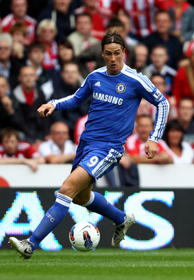 STOKE ON TRENT, ENGLAND - AUGUST 14:  Fernando Torres of Chelsea controls the ball during the Barclays Premier League match between Stoke City and Chelsea at the Britannia Stadium on August 14, 2011 in Stoke on Trent, England.  (Photo by Clive Brunskill/G
