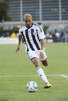 SANTA CLARA, CA - JULY 12: Peter Odemwingle #24 of West Bromwich Albion of the English Premier League dribbles the ball against the San Jose Earthquakes during a friendly soccer game at Buck Shaw Stadium on July 12, 2011 in Santa Clara, California. The Ea