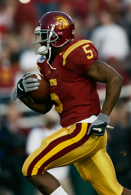 PASADENA, CA - JANUARY 04:  Running back Reggie Bush #5 of the USC Trojans warms-up before the start of the BCS National Championship Rose Bowl Game against the Texas Longhorns on January 4, 2006 in Pasadena, California.  (Photo by Donald Miralle/Getty Im