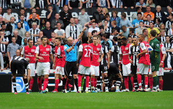 NEWCASTLE UPON TYNE, ENGLAND - AUGUST 13:  Gervinho of Arsenal is shown the red card by referee Peter Walton during the Barclays Premier League match between Newcastle United and Arsenal at St James' Park on August 13, 2011 in Newcastle upon Tyne, England