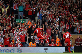 LIVERPOOL, ENGLAND - AUGUST 13:  Luis Suarez of Liverpool celebrates scoring the opening goal during the Barclays Premier League match between Liverpool and Sunderland at Anfield on August 13, 2011 in Liverpool, England.  (Photo by Clive Brunskill/Getty I