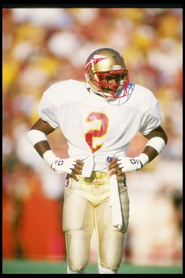 28 Nov 1987:  Cornerback Deion Sanders of the Florida State Seminoles stands on the field during a game against the Florida Gators at Florida Field in Gainesville, Florida.  Florida State won the game 28-14. Mandatory Credit: Allen Dean Steele  /Allsport