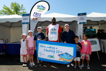 GLADSTONE, NJ - MAY 21: NFL player Muhammad Wilkerson of the New York Jets joins LPGA player Stephanie Louden and local junior golfers to support Blue Diamond Almonds 'Walk A Healthy 18' program at the Sybase Match Play Championship at Hamilton Farm Golf