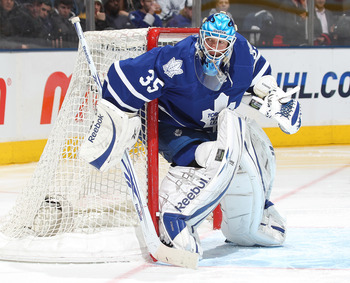 TORONTO, CANADA - FEBRUARY 07:  JS Giguere #35 of the Toronto Maple Leafs protects the corner in a game against the Atlanta Thrashers on February 7, 2011 at the Air Canada Centre in Toronto, Canada. The Leafs defeated the Thrashers 5-4. (Photo by Claus An