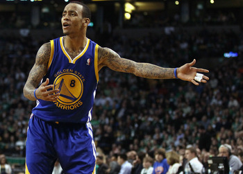 BOSTON, MA - MARCH 04:  Monta Ellis #8 of the Golden State Warriors reacts after the ball is given to the Boston Celtics on March 4, 2011 at the TD Garden in Boston, Massachusetts.  The Celtics defeated the Warriors 107-103. NOTE TO USER: User expressly a
