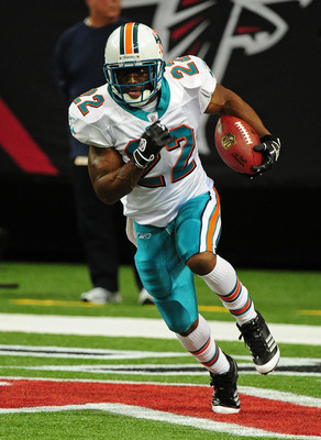 ATLANTA - AUGUST 12: Reggie Bush #22 of the Miami Dolphins carries the ball during warm-ups before their preseason game against the Atlanta Falcons at the Georgia Dome on August 12, 2011 in Atlanta, Georgia. (Photo by Scott Cunningham/Getty Images)