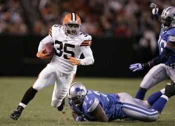 CLEVELAND - AUGUST 18:  Cleveland Browns running back Jerome Harrison #35 carries the ball for a first down against Detroit Lions defender Jon Bradley #77 in the fourth quarter of a pre-season game at Cleveland Browns Stadium August 18, 2007 in Cleveland,