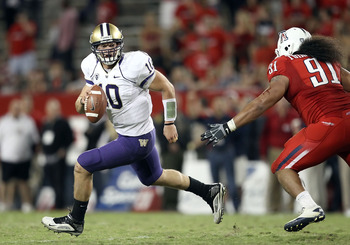 TUCSON, AZ - OCTOBER 23:  Quarterback Jake Locker #10 of the Washington Huskies scrambles with the football during the college football game against the Arizona Wildcats at Arizona Stadium on October 23, 2010 in Tucson, Arizona.  (Photo by Christian Peter