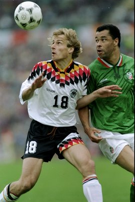 29 May 1994:  Jurgen Klinsmann of Germany is challenged by Paul McGrath of the Republic of Ireland during the international match played in Germany. The Republic of Ireland won the match 2-0. \ Mandatory Credit: Shaun  Botterill/Allsport