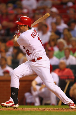 ST. LOUIS, MO - AUGUST 11: Lance Berkman #12 of the St. Louis Cardinals hits an RBI single against the Milwaukee Brewers at Busch Stadium on August 11, 2011 in St. Louis, Missouri.  (Photo by Dilip Vishwanat/Getty Images)