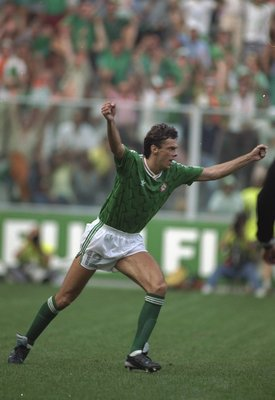 25 Jun 1990:  David O''Leary of Ireland celebrates scoring the winning goal in the penalty shoot-out during the World Cup match against Romania in Genoa, Italy. The match ended in a 0-0 draw but Ireland won 5-4 on penalties. \ Mandatory Credit: Allsport U