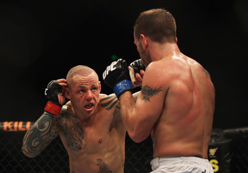 SYDNEY, AUSTRALIA - FEBRUARY 27:  Ross Pearson of Great Britain punches Spencer Fisher of the USA during their Lightweight bout UFC 127 at Acer Arena on February 27, 2011 in Sydney, Australia.  (Photo by Mark Kolbe/Getty Images)