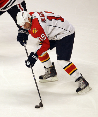 CHICAGO, IL - MARCH 23: Marty Reasoner #19 of the Florida Panthers controls the puck against the Chicago Blackhawks at the United Center on March 23, 2011 in Chicago, Illinois. The Blackhawks defeated the Panthers 4-0. (Photo by Jonathan Daniel/Getty Imag