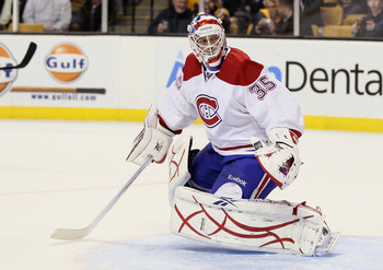 BOSTON, MA - MARCH 24:  Alex Auld #35 of the Montreal Canadiens stops a shot in the third period by the Boston Bruins on March 24, 2011 at the TD Garden in Boston, Massachusetts.  The Boston Bruins defeated the Montreal Canadiens 7-0.  (Photo by Elsa/Gett
