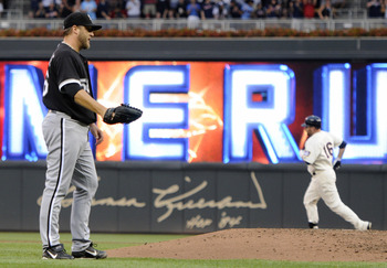 MINNEAPOLIS, MN - AUGUST 5: Mark Buehrle #56 of the Chicago White Sox reacts as Jason Kubel #16 of the Minnesota Twins rounds the bases following a two run home run in the first inning on August 5, 2011 at Target Field in Minneapolis, Minnesota. (Photo by