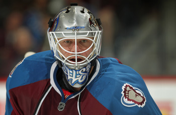 DENVER, CO - MARCH 22:  Goalie Brian Elliott #30 of the Colorado Avalanche looks on against the Columbus Blue Jackets at the Pepsi Center on March 22, 2011 in Denver, Colorado. Elliott had 29 saves including two in the shootout as the Avalanche defeated t