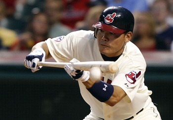 CLEVELAND, OH - AUGUST 13:   Kosuke Fukudome #1 of the Cleveland Indians bunts against the Minnesota Twins during the sixth inning of their game on August 13, 2011 at Progressive Field in Cleveland, Ohio.  The Indians defeated the Twins 3-1.  (Photo by Da