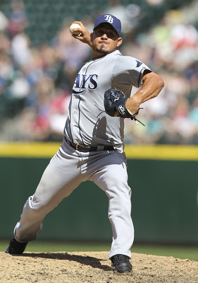 SEATTLE - JULY 30:  Relief pitcher Joel Peralta #62 of the Tampa Bay Rays pitches against the Seattle Mariners at Safeco Field on July 30, 2011 in Seattle, Washington. The Mariners defeated the Rays 3-2.(Photo by Otto Greule Jr/Getty Images)