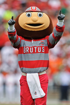 COLUMBUS, OH - SEPTEMBER 11:  Mascot Brutus Buckeye fires up the crowd before a game against the Miami Hurricanes at Ohio Stadium on September 11, 2010 in Columbus, Ohio.  (Photo by Jamie Sabau/Getty Images)