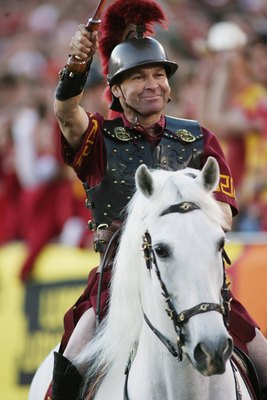 LOS ANGELES - DECEMBER 1:  Hector Aguilar smiles as he rides Traveler VII, mascot of the USC Trojans, during the game against the UCLA Bruins on December 1, 2007 at the Los Angeles Memorial Coliseum in Los Angeles, California.  USC won 24-7.  (Photo by Je