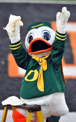 CORVALLIS, OR - DECEMBER 4: Oregon Ducks mascot 'Puddles' holds up some tortillas as time winds down in the fourth quarter of the game against the Oregon State Beavers at Reser Stadium on December 4, 2010 in Corvallis, Oregon. The Ducks beat the Beavers 3