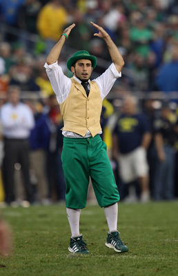 SOUTH BEND, IN - SEPTEMBER 11: The leprechaun mascot for the Notre Dame Fighting Irish performs during a game against the Michigan Wolverines at Notre Dame Stadium on September 11, 2010 in South Bend, Indiana. Michigan defeated Notre Dame 28-24.  (Photo b