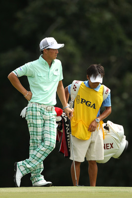 JOHNS CREEK, GA - AUGUST 11:  Ryo Ishikawa of Japan waits with his caddie Hiroyuki Kato during the first round of the 93rd PGA Championship at the Atlanta Athletic Club on August 11, 2011 in Johns Creek, Georgia.  (Photo by Andrew Redington/Getty Images)