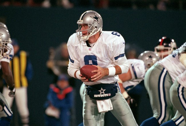 18 Oct 1999: Troy Aikman #8 of the Dallas Cowboys hands off the ball during a game against the New York Giants at the Giants Stadium in East Rutherford, New Jersey. The Giants defeated the Cowboys 16-13. Mandatory Credit: Ezra O. Shaw  /Allsport