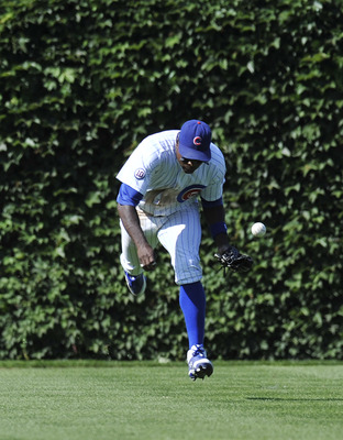 CHICAGO, IL - AUGUST 11: Alfonso Soriano #12 of the Chicago Cubs makes an attempt  on a line drive against the Washington Nationals  on August 11, 2011 at Wrigley Field in Chicago, Illinois. The Cubs defeated the Nationals 4-3. (Photo by David Banks/Getty