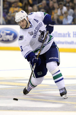 BOSTON, MA - JUNE 13:  Kevin Bieksa #3 of the Vancouver Canucks takes a shot against the Boston Bruins during Game Six of the 2011 NHL Stanley Cup Final at TD Garden on June 13, 2011 in Boston, Massachusetts.  (Photo by Harry How/Getty Images)