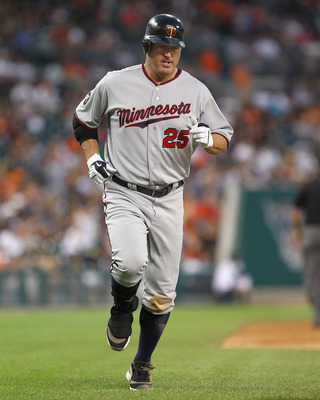 DETROIT, MI - AUGUST 15:  DH, Jim Thome #25 of the Minnesota Twins touches all the bases after hitting his first home run against the Detroit Tigers during a MLB game at Comerica Park on August 15, 2011 in Detroit, Michigan.  The Twins won 9-6 (Photo by D