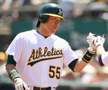 OAKLAND, CA - AUGUST 17:  Hideki Matsui #55 of the Oakland Athletics is congratulated by Cliff Pennington #2 of the Oakland Athletics after he scored in the first inning of their game against the Baltimore Orioles at O.co Coliseum on August 17, 2011 in Oa