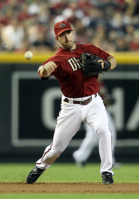 PHOENIX, AZ - AUGUST 14:  Infielder Willie Bloomquist #18 of the Arizona Diamondbacks fields a ground ball out against the New York Mets during the Major League Baseball game at Chase Field on August 14, 2011 in Phoenix, Arizona.  (Photo by Christian Pete